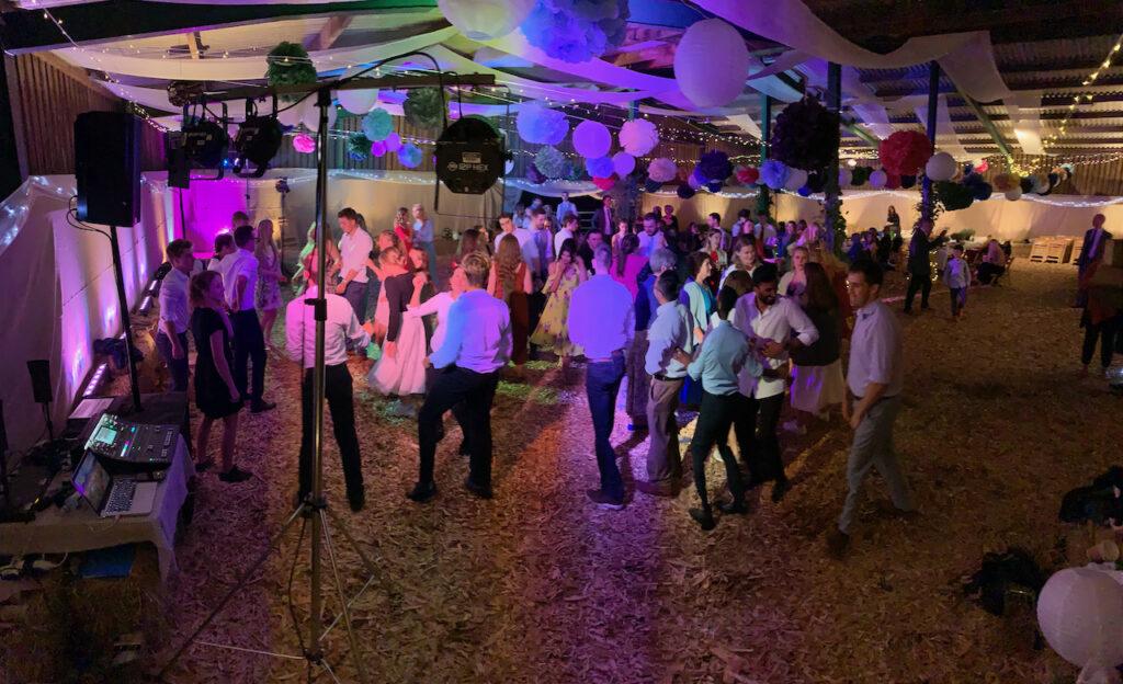 A crowd dancing at a wedding reception in a barn near Whimple, Devon