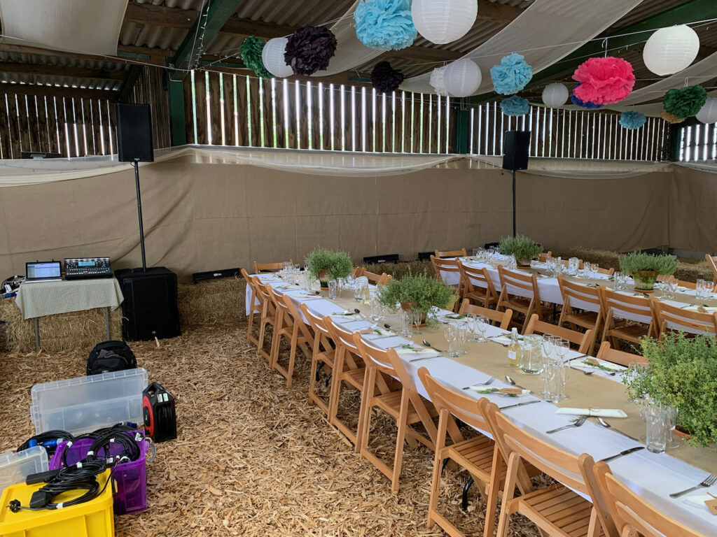 A PA system at a wedding reception in a barn at Cotley Farm, ready for speeches, a band and a DIY disco